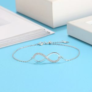 Infinity charm bracelet with pave detail