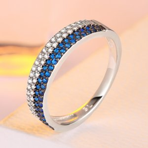 Double pave ring with blue and white zircons